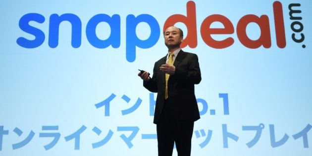 Chairman of Japanese mobile carrier SoftBank, Masayoshi Son, speaks about the company's investment over Indian leading online marketplace Snapdeal.com during a press conference in Tokyo on November 4, 2014. SoftBank said net profit in the first six months of its fiscal year jumped by more than a third, thanks to a five-billion-USD gain from its stake in Chinese e-commerce giant Alibaba.    AFP PHOTO / TOSHIFUMI KITAMURA        (Photo credit should read TOSHIFUMI KITAMURA/AFP/Getty Images)