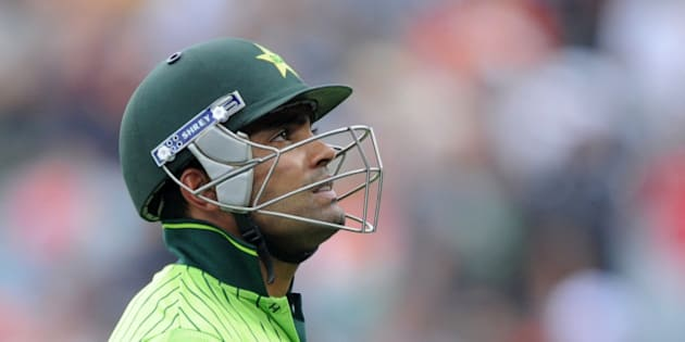 Pakistan's Umar Akmal walks from the field after he was dismissed for 13 runs during their Cricket World Cup Pool B match against South Africa in Auckland, New Zealand, Saturday, March 7, 2015. (AP Photo/Ross Setford)