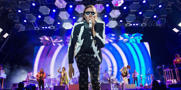GLASTONBURY, ENGLAND - JUNE 27:  Win Butler of Arcade Fire performs as the band headline the Pyramid Stage on Day 1 of the Glastonbury Festival at Worthy Farm on June 27, 2014 in Glastonbury, England.  (Photo by Samir Hussein/Redferns via Getty Images)