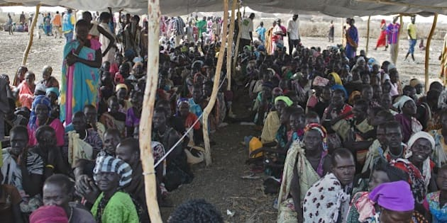 IDP's (Internally displaced persons) wait to receive food rations at the UNMISS Protection of Civilian (POC) site in Bentiu, Unity State, on February 27, 2015. The camp receives up to 200 new IDP each day, due to lack of services in the town. The World Health Organization today  appealed for 1.0 billion USD in additional funds to help provide life-saving health services to millions in need in conflict-ravaged Syria, Iraq, Central African Republic and South Sudan. For South Sudan, which has been wracked by fighting since an alleged attempted coup in December 2013, 90 million USD is needed to provide vital health services to some 3.35 million people, WHO said.  AFP PHOTO / CHARLES LOMODONG        (Photo credit should read CHARLES LOMODONG/AFP/Getty Images)