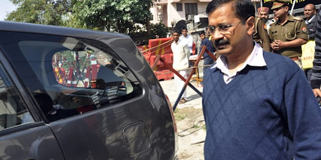 GHAZIABAD, INDIA - MARCH 4: AAP leader and Delhi Chief Minister Arvind Kejriwal leaves after the public meeting at his party office Kaushambi area on March 4, 2015 in Ghaziabad, India. The National Executive of AAP party decided not to have Yogendra Yadav in the party's key Political Affairs Committee, days after he and Prashant Bhushan questioned the functioning of party chief Arvind Kejriwal. (Photo by Sakib Ali/Hindustan Times via Getty Images)