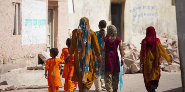INDIA - MARCH 15:  Indian women and girls dressed as wedding guests walking to the wedding in village of Rohet in Rajasthan, Northern India  (Photo by Tim Graham/Getty Images)