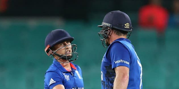England's James Taylor, left, congratulates teammate Ian Bell for completing a half century during their Cricket World Cup pool A match against Afghanistan in Sydney, Australia, Friday, March 13, 2015. (AP Photo/Rick Rycroft)
