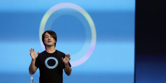 Microsoft corporate vice president Joe Belfiore, of the Operating Systems Group, gestures while demonstrating the new Cortana personal assistant during the keynote address of the Build Conference Wednesday, April 2, 2014, in San Francisco. Microsoft kicked off its annual conference for software developers, with new updates to the Windows 8 operating system and upcoming features for Windows Phone and Xbox. (AP Photo/Eric Risberg)