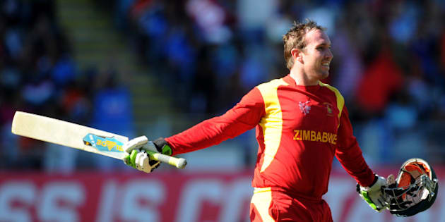 Zimbabwe's Brendan Taylor celebrates after scoring a century while batting against India during their Cricket World Cup Pool B match in Auckland, New Zealand, Saturday, March 14, 2015. (AP Photo/Ross Setford)