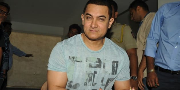 Indian Bollywood film actor, director, producer and television presenter Aamir Khan celebrates his 50th birthday the day before the event, at his home in Mumbai on March 13, 2015.  AFP PHOTO        (Photo credit should read STR/AFP/Getty Images)