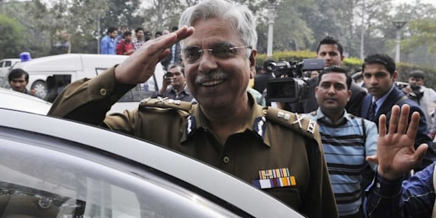 NEW DELHI, INDIA - FEBRUARY 16: Delhi Commissioner of Police, BS Bassi after meeting with the Delhi Chief Minister Arvind Kejriwal on his first day after taking oath a Delhi CM, as the media persons were not allowed the entry at Delhi Secretariat on February 16, 2015 in New Delhi, India. As media persons protested and demanded an answer to the ban of even accredited journalists inside the Delhi government office. Media persons were not allowed to visit the rooms of ministers and other offices inside the Delhi Secretariat. AAP government had restricted media entry inside the secretariat. (Photo by Sushil Kumar/Hindustan Times via Getty Images)
