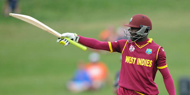West Indies batsman Jonathan Carter waves his bat to the crowd after reaching 50 runs during their Cricket World Cup Pool B match against the United Arab Emirates in Napier, New Zealand, Sunday, March 15, 2015. (AP Photo/Ross Setford)