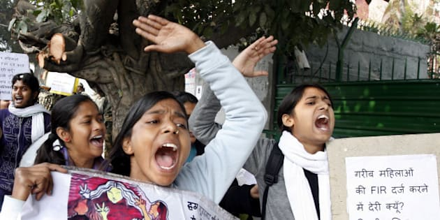 NEW DELHI, INDIA - JANUARY 13: Women protesters shouts slogans during a protest outside Delhi police headquarters against alleged police negligence in the murder and suspected rape of a woman January 13, 2015 in New Delhi, India. A 33-year-old woman was found gang-raped and brutally murdered in a Vasant Kunj nursery last week. (Photo by Arun Sharma/Hindustan Times via Getty Images)