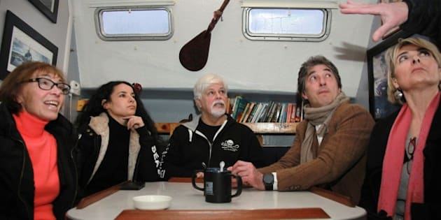 TO GO WITH AFP STORY BY CELINE SERRAT NGO Sea Shepherd Conservation Society founder, Paul Watson of Canada (C) talks to (LtoR) Sylvie Rocard, French former Prime minister Michel Rocard's wife and Brigitte Bardot foundation administrator, a crew member, Brigitte Bardot foundation spokesman Christophe Marie and General Director Ghyslaine Calmels-Bock on board of the 'Brigitte Bardot', a Sea Shepherd multihull moored in Paris, on January 15, 2015. Watson, targeted by an arrest request by Interpol since 2012 launched by Japan, an active whale hunter, who was in exil at sea, has been sheltered in France for several months.  AFP PHOTO LOIC VENANCE        (Photo credit should read LOIC VENANCE/AFP/Getty Images)