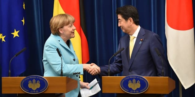 German Chancellor Angela Merkel (L) and Japanese Prime Minister Shinzo Abe (R) shake hands after their joint press conference at the latter's official residence in Tokyo on March 9, 2015. Merkel is on a two-day visit to Japan.  AFP PHOTO / KAZUHIRO NOGI        (Photo credit should read KAZUHIRO NOGI/AFP/Getty Images)