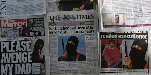An arrangment of British daily newspapers photographed in London on February 27, 2015 shows the front-page headlines and stories regarding the identification of the masked Islamic State group militant dubbed 'Jihadi John'. The British headlines were dominated on Febryary 27 by the story of the identification of the Islamic State executioner. 'Jihadi John', the masked Islamic State group militant believed responsible for beheading of at least five Western hostages, has been named as Kuwaiti-born computing graduate Mohammed Emwazi from London.  AFP PHOTO / DANIEL SORABJI        (Photo credit should read DANIEL SORABJI/AFP/Getty Images)