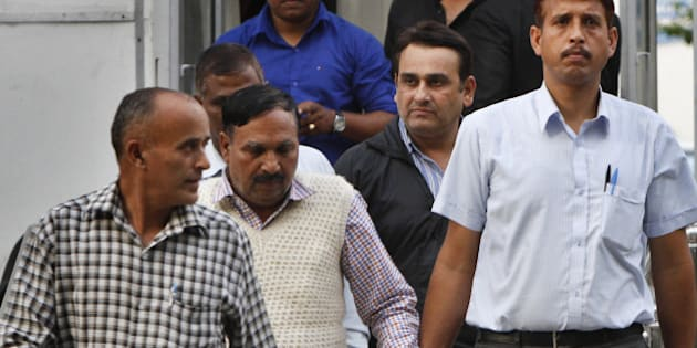NEW DELHI, INDIA - MARCH 13: Two accused being taken to be produced in special CBI court in the leakage of confidential documents related to foreign investments in the finance and commerce ministries on March 13, 2015 in New Delhi, India.  Three people, including two government officials were arrested yesterday in the leakage of confidential documents related to foreign investments in the finance and commerce ministries. (Photo by Arun Sharma/Hindustan Times via Getty Images)