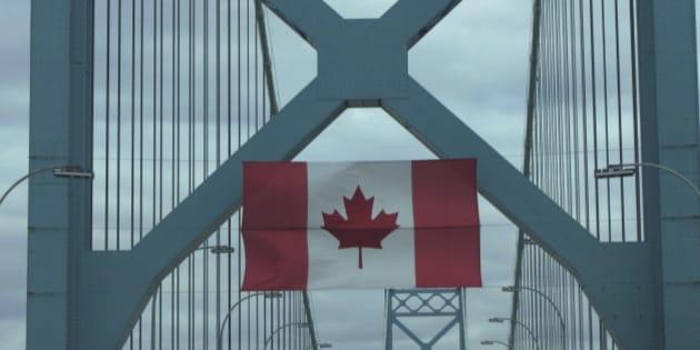 Canadian flag hanging on Ambassador bridge.