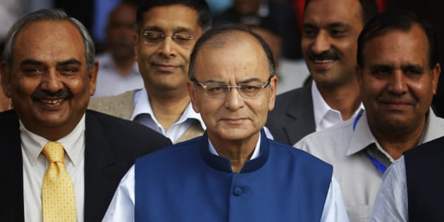 Indian Finance Minister Arun Jaitley holds a briefcase containing union budget for the year 2015-16 as he leaves his office for Parliament to present the union budget in New Delhi, India, Saturday, Feb. 28, 2015. (AP Photo/Altaf Qadri)