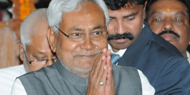 PATNA, INDIA  MARCH 11: Bihar Chief Minister Nitish Kumar greets his MLAs before the confidence motion in State Assembly on March 11, 2015 in Patna, India. Bihar Chief Minister Nitish Kumar won the confidence vote with the help of RJD, Congress, CPI and one Independent MLAs in the Assembly. Kumar was sworn-in as Chief Minister of Bihar for the fourth time on February 22 last. (Photo by AP Dube/Hindustan Times via Getty Images)
