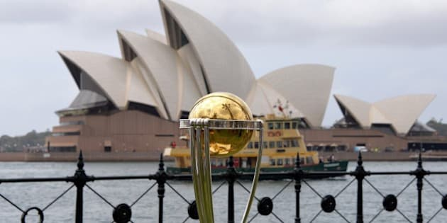 The Cricket World Cup trophy is seen in front of the Australia's iconic land mark Opera House during a media event for the 100-day countdown to the 2015 Cricket World Cup in Sydney on November 6, 2014.  Australia and New Zealand are hosting the Cricket World Cup 2015 starting from February 14 with the match between Australia and England in Melbourne.    AFP PHOTO / Saeed KHAN     --- IMAGE STRICTLY FOR EDITORIAL USE  STRICTLY NO COMMERCIAL USE ----        (Photo credit should read SAEED KHAN/AFP/Getty Images)