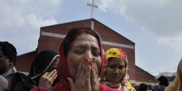 Pakistani Christian women mourn as they gather at a church damaged from a suicide bombing attack in Lahore, Pakistan, Sunday, March 15, 2015. Suicide bombers exploded themselves near two churches in the eastern city of Lahore on Sunday as worshippers were gathered inside, killing at least a dozen people, officials said, in the latest attack against religious minorities in the country. (AP Photo/K.M. Chaudary)
