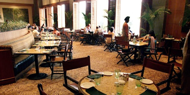 Very few guests are seen eating in the Machan restaurant of Taj Mansingh Hotel in New Delhi, India, in this Oct. 10, 2001 photo. In India, just as in other tourist hotspots in India, Nepal and Bhutan, it's obvious that foreign tourists, spooked by the U.S.-led strikes on Afghanistan, are avoiding the region.  (AP Photo/Manish Swarup)