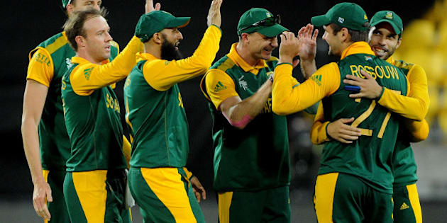 South Africa's Rilee Rossouw is congratulated by teammates after taking a catch to dismiss United Arab Emirates batsman Saqlain Haider during their Cricket World Cup Pool B match in Wellington, New Zealand, Thursday, March 12, 2015. (AP Photo/Ross Setford)