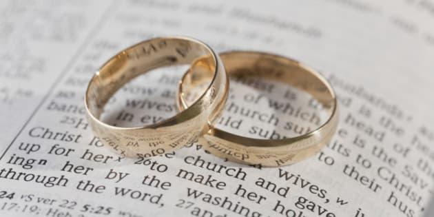 Wedding rings on top of an open bible
