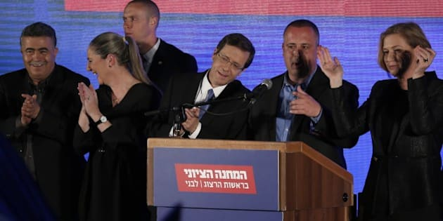Co-leaders of the Zionist Union party, Israeli Labour Party leader Isaac Herzog (3rd from R) and Israeli MP Tzipi Livni (R), stand on stage as they react to exit poll figures in Israel's parliamentary elections late on March 17, 2015 at the party's headquarters in the city of Tel Aviv. Herzog said he is still in the race to form Israel's next government after exit polls showed a last-minute surge by the rightwing Likud, leaving the two parties neck-and-neck. AFP PHOTO / THOMAS COEX        (Photo credit should read THOMAS COEX/AFP/Getty Images)
