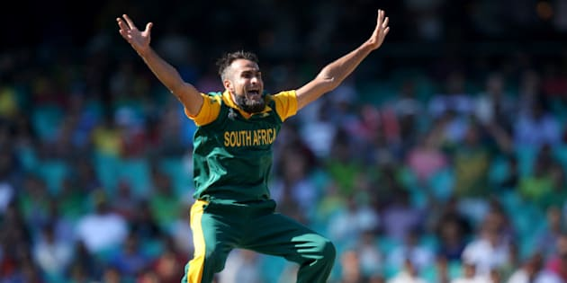 South African bowler Imran Tahir appeals to the umpire for a dismissal during their Cricket World Cup quarterfinal match against Sri Lanka in Sydney, Australia, Wednesday, March 18, 2015. (AP Photo/Rick Rycroft)