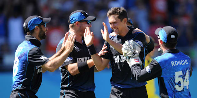 New Zealand's Trent Boult, second right, is congratulated by his teammates after taking the wicket of Australia's Mitchell Marsh during their Cricket World Cup match in Auckland, New Zealand, Saturday, Feb. 28, 2015. (AP Photo Ross Setford)