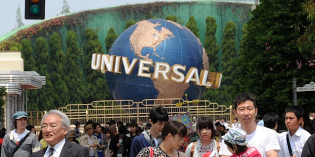 Visitors enjoy a tour at the movie theme park Universal Studios Japan (USJ) in Osaka on May 10, 2012. USJ unveiled plans to build the first international version of the theme park 'Wizarding World of Harry Potter' in Osaka.   AFP PHOTO / YOSHIKAZU TSUNO        (Photo credit should read YOSHIKAZU TSUNO/AFP/GettyImages)