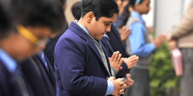 NEW DELHI, INDIA - DECEMBER 17: School students all over India observed two minutes of silence in remembrance of the children in Peshawar who lost their lives in a Taliban terrorist attack on 16 december 2014 in New Delhi, India, on Wednesday, December 17, 2014. (Photo by Saumya Khandelwal/ Hindustan Times)