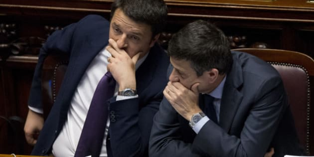 Italian premier Matteo Renzi, left, talks with Infrastructure Minister Maurizio Lupi prior to a confidence vote in the Chamber of Deputies, in Rome, Tuesday, Feb. 25, 2014. The Senate voted 169-139 to confirm Renzi's broad coalition, which ranges from his center-left Democrats to center-right forces formerly loyal to ex-premier Silvio Berlusconi. Renzi needed at least 155 votes to clinch the victory, one of two mandatory confidence votes. The second vote, in the Chamber of Deputies, is expected later Tuesday. Renzi's coalition has a comfortable majority in the lower chamber. (AP Photo/Andrew Medichini)