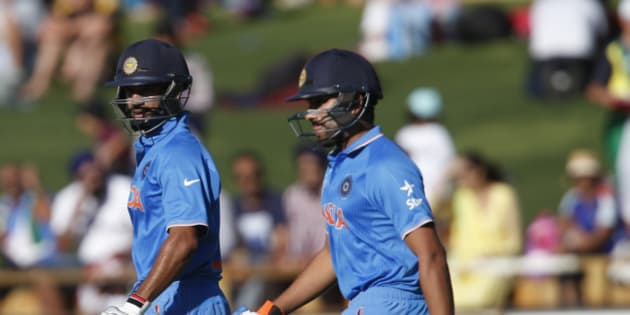 India's Shikhar Dhawan left, and Rohit Sharma walk onto the field to start the Indian batting attack during their Cricket World Cup Pool B match against the United Arab Emirates in Perth, Australia, Saturday, Feb 28, 2015. (AP Photo/Theron Kirkman)