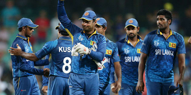 Sri Lanka's Kumar Sangakkara waves to the crowd as he leaves the field after his teams nine wicket loss to South Africa in their Cricket World Cup quarterfinal match in Sydney, Australia, Wednesday, March 18, 2015.(AP Photo/Rob Griffith)