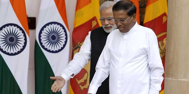NEW DELHI, INDIA - FEBRUARY 16: Prime Minister Narendra Modi and Sri Lankan President Maithripala Sirisena during a meeting and delegation-level talks at Hyderabad House on February 16, 2015 in New Delhi, India. Sirisena said,'This is my first visit and it has given very fruitful results.' India sealed a nuclear energy agreement with Sri Lanka, its first breakthrough with the new government. (Photo by Virendra Singh Gossain/Hindustan Times via Getty Images)