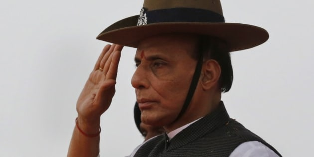 Indian Home Minister Rajnath Singh takes salute as he receives a guard of honor during a visit to a Rapid Action Force Camp in Allahabad, India, Wednesday, Jan.28, 2015. (AP Photo/ Rajesh Kumar Singh)
