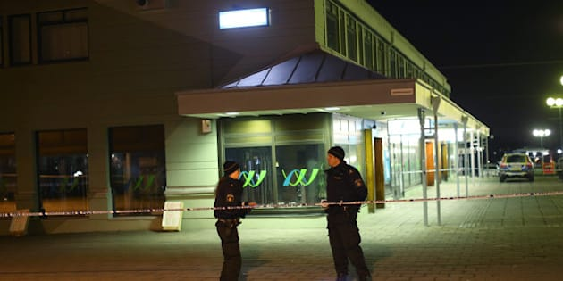 Police officers examine the scene of a fatal shooting in Gothenburg, Sweden, late Wednesday, March 18, 2015. Several people were shot inside a restaurant in the city late Wednesday and at least two of them have died, Swedish police said. (AP Photo/ TT News Agency, Bjorn Larsson Rosvall) SWEDEN OUT