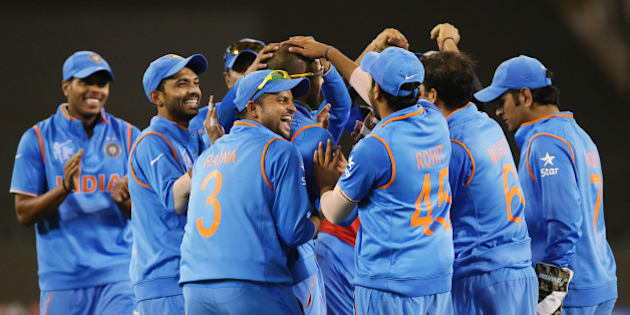 Indian players celebrate the dismissal of Bangladesh's Mahmudullah during their Cricket World Cup quarterfinal match in Melbourne, Australia, Thursday, March 19, 2015. (AP Photo/Rick Rycroft)