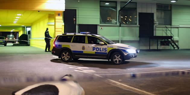 A police officer examines the scene of a fatal shooting in Gothenburg, Sweden, late Wednesday, March 18, 2015. Several people were shot inside a restaurant in the city of Goteborg late Wednesday and at least two of them have died, Swedish police said. (AP Photo/ TT News Agency, Bjorn Larsson Rosvall) SWEDEN OUT