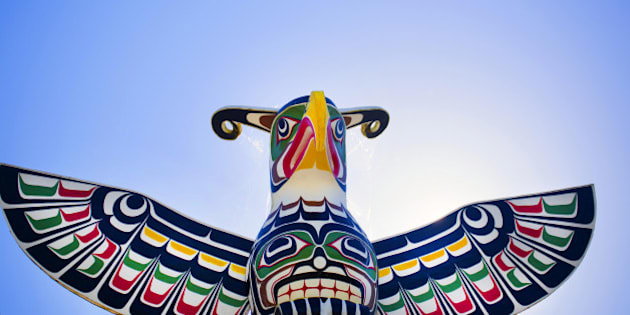 Alert Bay village welcoming totem pole of thunderbird.