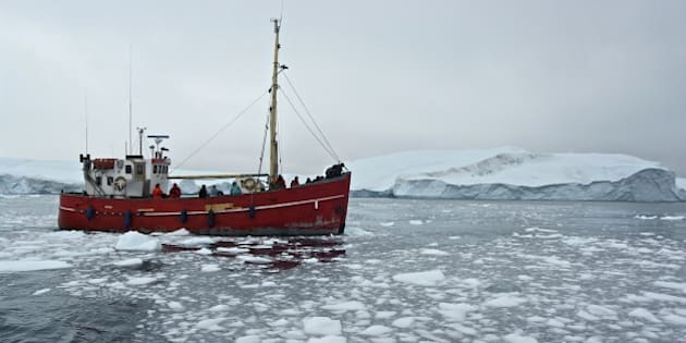 GREENLAND - AUGUST 02: Ship among the icebergs that have broken off the Sermeq Kujalleq ice sheet, Ilulissat, Qaasuitsup, Greenland. (Photo by DeAgostini/Getty Images)