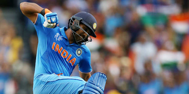 India's Rohit Sharma celebrates after scoring a century while batting against Bangladesh during their Cricket World Cup quarterfinal match in Melbourne, Australia, Thursday, March 19, 2015. (AP Photo/Rick Rycroft)
