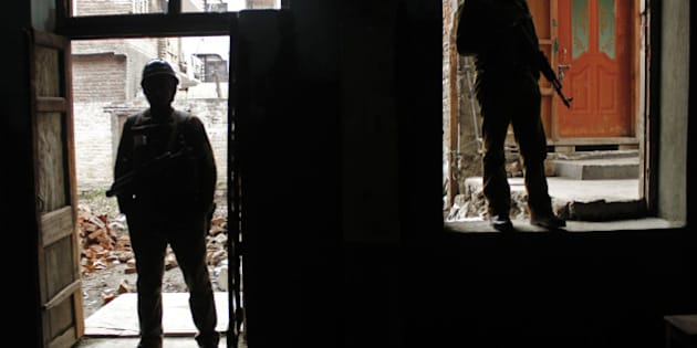 SRINAGAR, INDIA - DECEMBER 14: Indian paramilitary soldiers stand guard inside a polling station during the fourth phase of polls in capital Srinagar on December 14, 2014. Indian-held Kashmir headed to the fourth phase of state assembly polls under tight security, even as most pro-independence groups, who reject India's sovereignty over the disputed Himalayan region, have asked people to boycott the five phased polls starting on November 25 and ending on December 20. The elections are being held in five stages to allow government forces to better guard against any violence or anti-India protests.  (Photo by Ahmer Khan/Anadolu Agency/Getty Images)