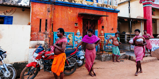 BHUBANESHWAR, ORISSA, INDIA - 2014/01/05: Group of men in lungi in front of a temple. (Photo by Raquel Maria Carbonell Pagola/LightRocket via Getty Images)