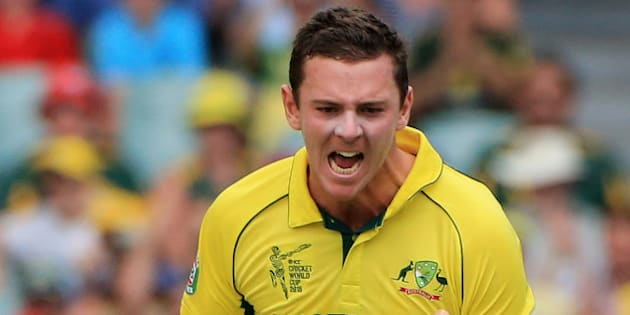 Australia's Josh Hazlewood celebrates after taking the wicket of Pakistan's Ahmad Shahzad during their Cricket World Cup quarterfinal match in Adelaide, Australia, Friday, March 20, 2015. (AP Photo/James Elsby)