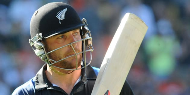New Zealand batsman Brendon McCullum waves his bat as he leaves the field after he was dismissed for 77 runs during their Cricket World Cup match against England in Wellington, New Zealand, Friday Feb. 20, 2015. (AP Photo/Ross Setford)