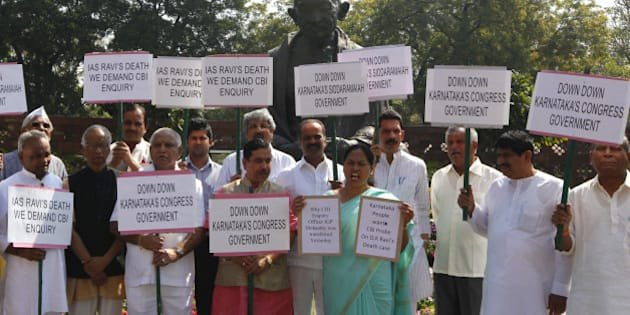 NEW DELHI, INDIA - MARCH 19: MPs from Karnataka protesting and demanding CBI probe on DK Ravi's death case at Parliament house on March 19, 2015 in New Delhi, India. Opposition forced deferment of consideration of the contentious Mines and Minerals Bill in Rajya Sabha till tomorrow, arguing that mineral-bearing states had not been consulted. (Photo by Arvind Yadav/Hindustan Times via Getty Images)