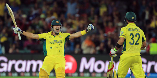 Australia's Shane Watson, left, celebrates with teammate Glenn Maxwell after they defeated Pakistan by six wickets in their Cricket World Cup quarterfinal match in Adelaide, Australia, Friday, March 20, 2015. (AP Photo/James Elsby)