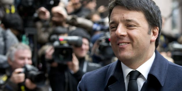 Italian Prime Minister Matteo Renzi arrives for an EU summit in Brussels on Friday, March 20, 2015. EU leaders on Friday are looking to back U.N.-brokered efforts to form a national unity government in conflict-torn Libya that may include a possible mission to help provide security. (AP Photo/Francoise Mori)