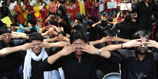 Protesters take part in a street play during a protest against growing cases of sexual abuse in New Delhi on May 5,2012. The protesters urged the police to take quick action over complaints of sexual abuse and stop making comments that suggest that women are to be blamed for acts of sexual abuse.   AFP PHOTO/SAJJAD HUSSAIN        (Photo credit should read SAJJAD HUSSAIN/AFP/GettyImages)