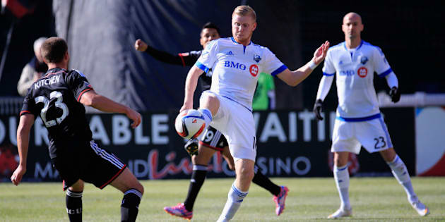 WASHINGTON, DC - MARCH 07: Perry Kitchen #23 of D.C. United defends as Calum Mallace #16 of Montreal Impact kicks the ball during the first half at RFK Stadium on March 7, 2015 in Washington, DC.  (Photo by Rob Carr/Getty Images)